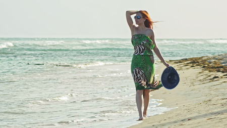 puertorico: Young woman with long red hair walking at seascape beach in Dominican Republic, Caribbean sea