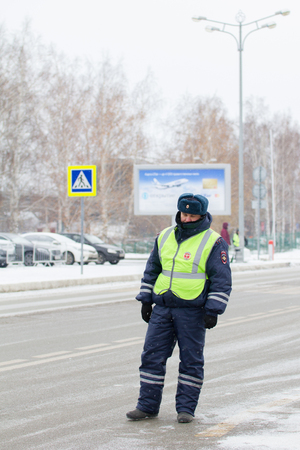 traffic warden: Kazan, Russia, 17 november 2016, Russian policeman in uniform in international Airport Kazan, telephoto Editorial