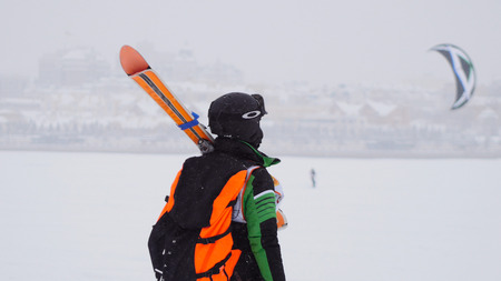 snowkiting: Kite surfer ready for sliding. Snowkiting in the snow on frozen river