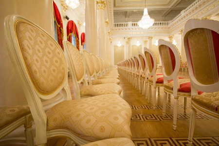 Empty golden luxury chairs in the ballroom