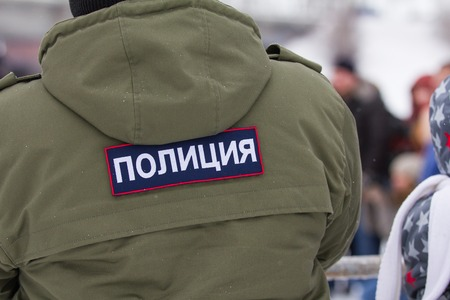 kreml: Russian police - emblem on the back OMON at winter day