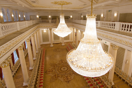 KAZAN, RUSSIA - 16 JANUARY 2017, City Hall - luxury and beautiful touristic place - view of golden ballroom, crystal chandelier