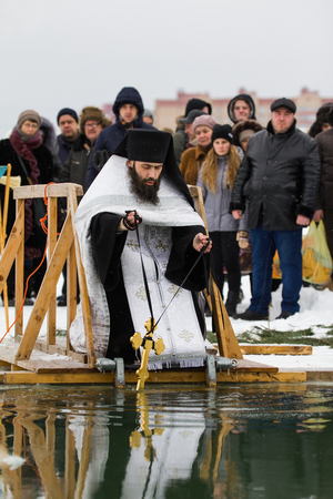 KAZAN, RUSSIA - JANUARY 19, 2017: Jesus Christs baptism holiday on kazanka river. Traditional winter bathing in center of city, telephoto
