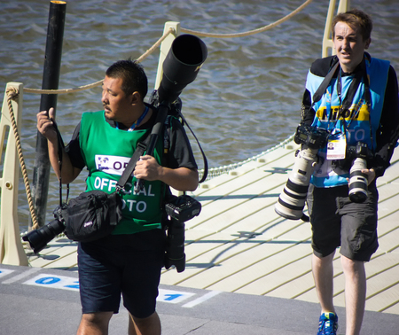 vasas: Kazan, Russia, 3 august 2015, FINA - High diving competition: sport photographers carries a lot of equipment Editorial