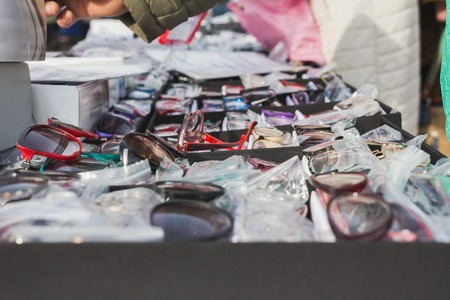 Illegal street dealers sell glasses, close up