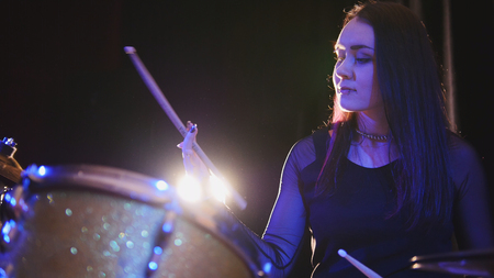 down beat: Teen rock music - gothic girl percussion drummer perform music break down Stock Photo