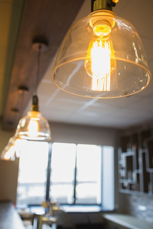 Incandescent lamps in a modern cafe - cozy interior