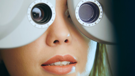 Ophthalmology - young woman checks the eyes on the modern equipment in the medical center Stock Photo