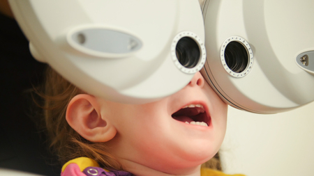Healthcare - little beautiful girl in ophthalmologist room