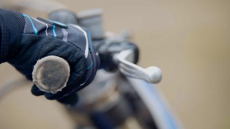 chrome man: Cross motorcycle engine start. MX, close up shot of hand on handlebar