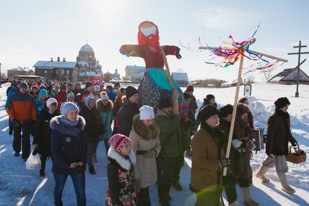 Kazan, Russia - 28 february 2017 - Sviyazhsk Island : Russian ethnic carnival Maslenitsa - The pancake week, Shrovetide, the crowd carries the effigy of winter to burn - top view