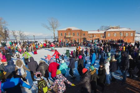 maslenitsa: Sviyazhsk, Russia - 26 February 2017: The pancake week - Russian ethnic carnival, Maslenitsa Shrovetide the crowd dances before the burning of winters effigies Editorial
