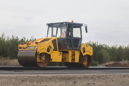 roller compactor: Asphalt compactor - road rollers at asphalt pavement works Stock Photo
