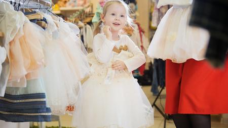 Little girl really likes white ball gownLittle girl really likes white ball gown