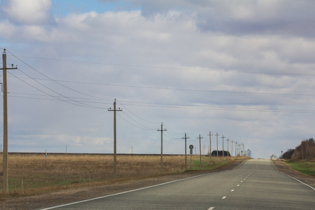 Road among fields - spring countryside in Russia