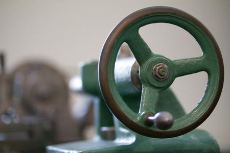 Handle of antique lathe, blurred