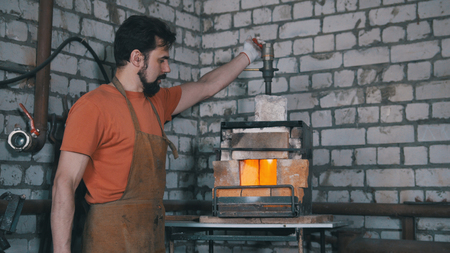 forge: The blacksmith in forge near furnace