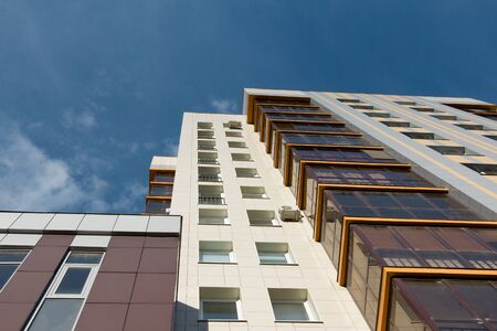 Multi-storey residential apartment buildings over blue sky Stock Photo