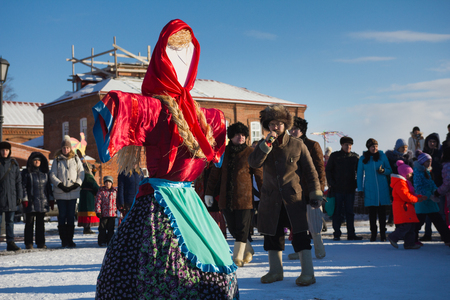 Kazan, Russia - 28 february 2017 - Sviyazhsk Island : Russian ethnic carnival Maslenitsa - Scarecrow winter in the square - a frosty sunny day