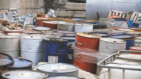 deteriorate: Barrels with spent oil products - ecology concept