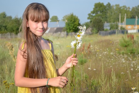 simple girl: Happy teen girl at summer meadow, collecting flowers