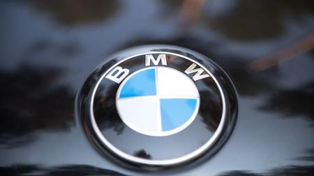 Kazan, RUSSIA july 2017: Sign of a BMW logo on black car - popular luxury sport car