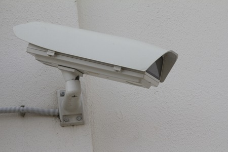 private security: Big CCTV Camera on the wall - telephoto