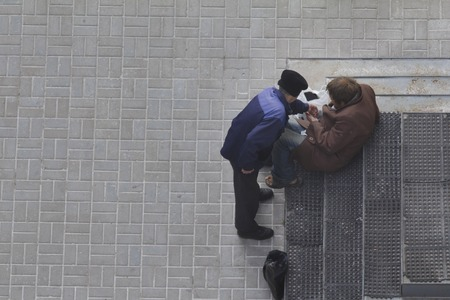 durty: Two beggars near orthodox church in Russia