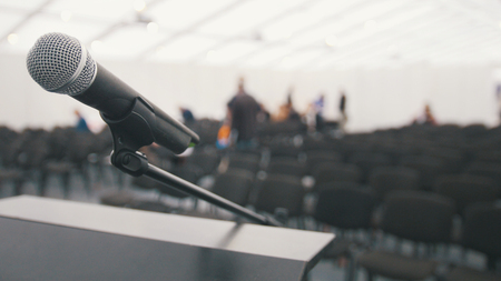 Microphone on stage in auditorium waiting for performances, close up