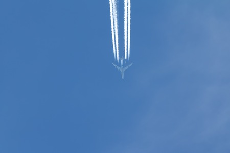 Jet is flying in the blue sky, horizontal
