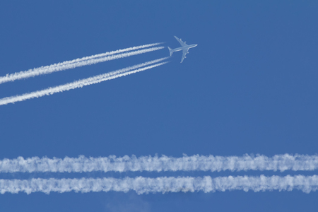 Passengers airplane is flying in perfect blue sky
