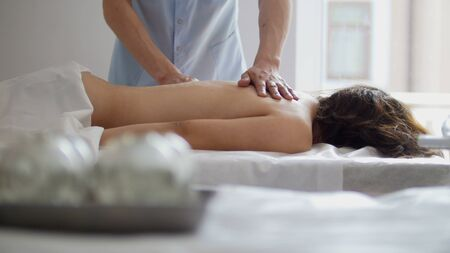 Spa. In the massage bank create a vacuum against the background of a woman