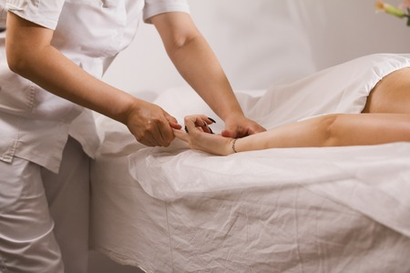 Finger massage - tibetian massage in spa salon for young woman