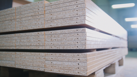 Stack of wood particleboard panels on the warehouse or factory