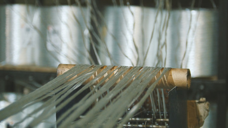 Producing fiberglass rods - manufacture of composite reinforcement, industry for construction, close up