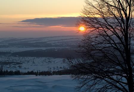 Winter snowy rural landscape at sunrise Stock Photo