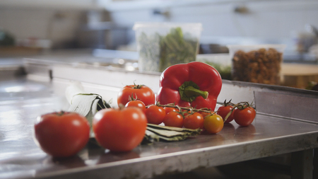 Vegetables, tomatoes, paprika, leeks lying on the table in the commercial kitchen Stock Photo