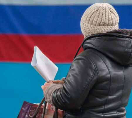 Russian presidential election - a woman with ballot paper ready make her political choice