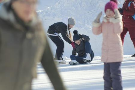 Girls Teens having fun at winter skate ring