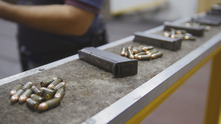 Pistol clips with bullets in shooting gallery Stock Photo