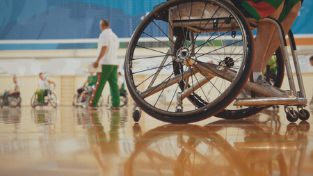 Wheel of handicapped basketball player in a wheelchair during sportive training Stock Photo