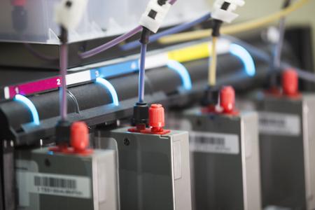 Ink cartridges inside modern professional printing machine