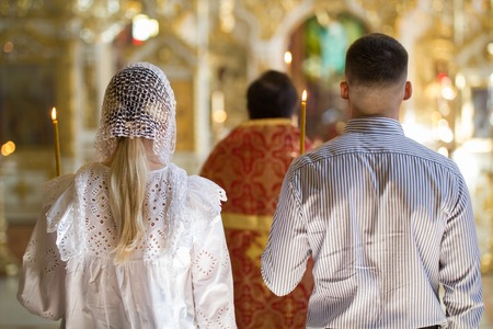Back view of bride and groom on orthodox wedding ceremony in the church Stock Photo