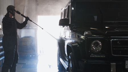 Washing a luxury car in the suds