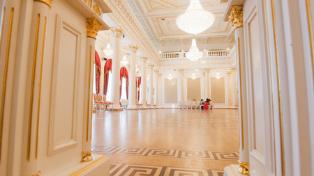 KAZAN, RUSSIA - MARCH 30, 2018:, City Hall - luxury ballroom - preparing for historical dance party