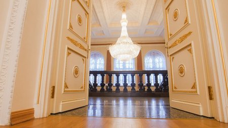 KAZAN, RUSSIA - MARCH 30, 2018:, ladder in City Hall - luxury ballroom - preparing for historical dance party