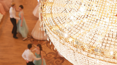 Couples dancing waltz in the vintage ball costumes