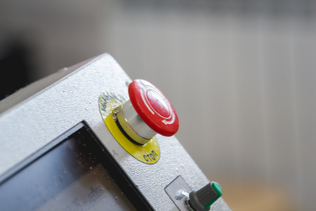 Red emergency stop switch reset button on machinery industry