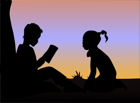Silhouette of boy and girl reading books under the tree at sunset
