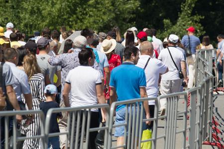 KAZAN, RUSSIA - JUNE 23, 2018: Traditional Tatar festival Sabantuy - many people walking at celebration in summer park